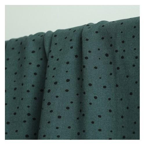 tissu viscose pois noirs fond vert