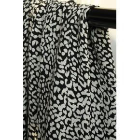 tissu leo noir et blanc - un chat sur un fil